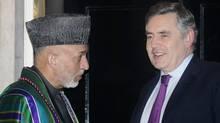 Afghan President Hamid Karzai, left, and British Prime Minister Gordon Brown speak in London.