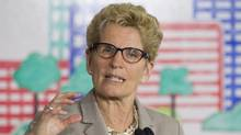 Ontario Premier Kathleen Wynne addresses the media during an announcement which outlined a cap and trade deal with Quebec aimed at curbing green house emissions, in Toronto on Monday, April 13 2015. (Chris Young/THE CANADIAN PRESS)