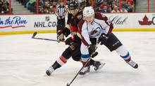 Colorado Avalanche centre Nathan MacKinnon (29) takes the puck away from Ottawa Senators defenceman Erik Karlsson (65) in the first period at the Canadian Tire Centre. (Marc DesRosiers-USA TODAY Sports/USA Today Sports)