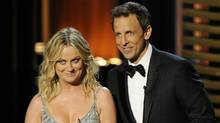 Amy Poehler, left, and Host Seth Meyers speak on stage at the 66th Annual Primetime Emmy Awards at the Nokia Theatre L.A. Live on Monday, Aug. 25, 2014, in Los Angeles. (Chris Pizzello/Invision/AP)