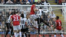 Manchester United's Jonny Evans (C) heads to score against Newcastle United during their English Premier League soccer match in Newcastle, northern England, October 7, 2012. (Reuters)
