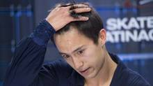 Canada's Patrick Chan reacts to his marks for his short program in the men's competition at Skate Canada International in Windsor, Ont., on Friday, October 26, 2012. (CP)