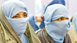 Teenage girls attend an event to pray for peace to commemorate International Women's Day in Kandahar City, one of the most volatile parts of Afghanistan. In a region where women seldom leave home for any reason, a public gathering like this one of hundreds of women is unusual and attests to their strong wish to advocate for peace.