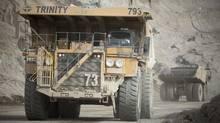 Dump trucks move waste rock around the Highland Valley Copper Mine in British Columbia. (JOHN LEHMANN/GLOBE AND MAIL)