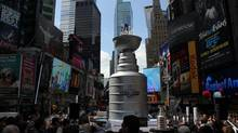 "A 21-foot high, 6,600-pound replica of the Stanley Cup will take a commanding presence in New York City""s Times Square for three days beginning Wednesday."