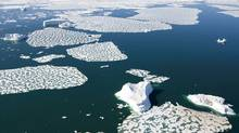 Ice patterns and icebergs are seen in Croaker Bay near Devon Island in Canada's Arctic, July, 2008. (JONATHAN HAYWARD/THE CANADIAN PRESS)