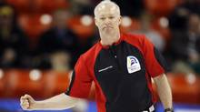 tario skip Glenn Howard celebrates his win over Northern Ontario during their playoff game at the Brier curling championships in Halifax, Nova Scotia, March 12, 2010. REUTERS/Shaun Best (SHAUN BEST)