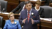 Ontario Finance Minister Charles Sousa delivers the provincial budget as Premier Kathleen Wynne looks on at Queens Park in Toronto, May 1, 2014 (MARK BLINCH/Reuters)