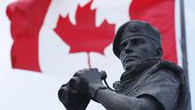 The Canadian Flag flies over the Peacekeeping memorial in Ottawa Tuesday May 29, 2012. (Adrian Wyld/THE CANADIAN PRESS)