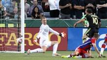 Midfielder Landon Donovan of the Los Angeles Galaxy scores a goal past Bayern Munich goalkeeper Manuel Neuer (Jaime Valdez/USA Today Sports)