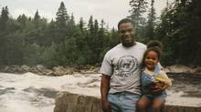 A family photo of Warrant Officer Jowel Fils-Aimé with his daughter, Janice, taken in 1995 near the Jacques Cartier River at Canadian Forces Base Valcartier. Warrent Officer Fils-Aimé took his own life in the river on Oct. 8, 2008. (Photo courtesy Fils-Aimé family)