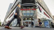 Pedestrians pass a Canadian Tire store in downtown Toronto. (MARK BLINCH/REUTERS)
