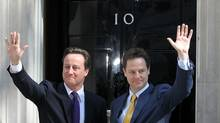 British Prime Minister David Cameron welcomes Deputy Prime Minister Nick Clegg, right, to Downing Street for their first day of coalition government on May 12, 2010 in London, England. (Matt Cardy/Matt Cardy/Getty Images)