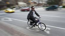 A cyclist rides in the bike lanes on Jarvis Street in Toronto on Tuesday, April 3, 2012. (Kevin Van Paassen/The Globe and Mail)
