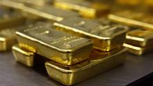 Gold bars are stacked in the safe deposit boxes room of the Pro Aurum gold house in Munich March 3, 2014. (MICHAEL DALDER/REUTERS)