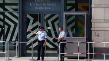 Security officers stand outside the U.S. Embassy in Berlin July 10, 2014. Germany asked the top U.S. intelligence official at the Berlin embassy on Thursday to leave the country, a highly unusual step reflecting the deep anger within Angela Merkel's government at the discovery of two suspected U.S. spies within a week. (THOMAS PETER/REUTERS)