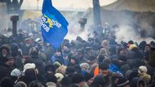 Pro-government supporters rally outside the Ukraine parliament on Jan. 28, 2014 before a vote to repeal the anti-protest laws. (John Lehmann/The Globe and Mail)