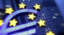 The illuminated euro sign is seen in front of the headquarters of the European Central Bank (ECB) in Frankfurt. (KAI PFAFFENBACH/REUTERS)