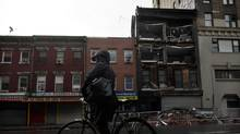 A woman looks at a damaged building that collapsed during Hurricane Sandy in New York October 29, 2012 (Brendan McDermid/Reuters)