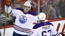 Edmonton Oilers' Connor McDavid celebrates one of his two goals in a 5-2 win over the Calgary Flames on Oct. 17. (Jeff McIntosh/THE CANADIAN PRESS)