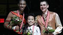 Gold medalist Nam Nguyen stands between silver medalist Shaquille Davis and bronze medalist Peter O'Brien after the junior men's competition Thursday atthe Canadian figure skating championships. (Skate Canada/F.Scott Grant)