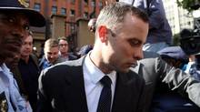 Oscar Pistorius, leaves the high court in Pretoria, South Africa, Tuesday, April 8, 2014. (Themba Hadebe/AP)