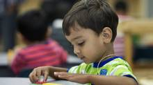 Four-year-old Zain Siddiqui attends his first day of school at Fraser Mustard Learning Academy in Toronto on Sept. 3, 2013. He had a two-part plan for his first full day of kindergarten: to colour and to play. (Kevin Van Paassen/The Globe and Mail)