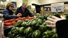 Longo's grocery store shoppers check over the selection of peppers on sale in the produce department at Longo's grocery store on York Mills Road in North Toronto. (Deborah Baic/Deborah Baic/The Globe and Mail)