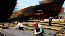 China's export and import data for June may show a third consecutive trade surplus and spark calls for a faster appreciation in the yuan. (STR/AFP/Getty Images)