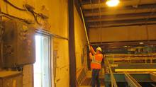 Crystal Wood cleans beams on the outside wall by MLU transfer at The Mackenzie mill.