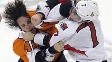 Philadelphia Flyers center Danny Briere, left, and Ottawa Senators center Kyle Turris trade blows in an NHL game on Jan. 7, 2012. (TIM SHAFFER/REUTERS)