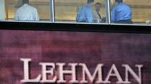 In this Sept. 16, 2008 file photo, people work inside the Lehman Brothers headquarters in New York. (MARY ALTAFFER/AP)