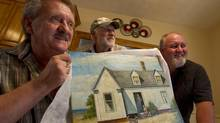 Ron Flarity, left, Ken Marshall and Blair Mooney, of Owen Sound, Ont., three of the principal owners of a painting that Ron bought on eBay in 2007. They believe it is an original Hopper painting, and potentially worth millions of dollars. (Peter Power/The Globe and Mail)