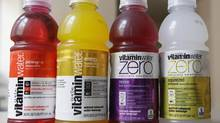 Coca-Cola company's Vitaminwater drinks have 120 calories from sugar (the equivalent of eight teaspoons of sugar) in a 591-millilitre bottle. (Stephan Savoia/The Associated Press)