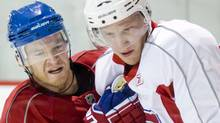 Montreal Canadiens' Jeff Halpern, left, checks Canadiens' Lars Eller during training camp in Brossard, Que., Saturday, Sept., 18, 2010. THE CANADIAN PRESS/Graham Hughes (Graham Hughes)