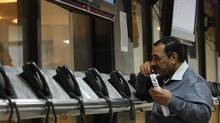 An investor speaks on the phone during trading hours at the Iraq Stock Exchange in Baghdad, Feb. 20, 2012. Foreign investors may be attracted by the IPOs of Iraq's telecom operators if they happen later this year. (Mohammed Ameen/Reuters/Mohammed Ameen/Reuters)