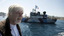 President of the Sea Shepherd Conservation Society, Paul Watson, answers questions while sailing aboard a trimaran off the harbor of La Ciotat, southern France, May 25, 2011. (Patrick Gherdoussi/The Associated Press/Patrick Gherdoussi/The Associated Press)