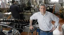Brian Titus, owner of Garrison Brewery, at the bottle assembly line at his Halifax plant, May 25, 2011 (PAUL DARROW FOR THE GLOBE AND MAIL)