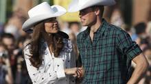 Prince William and his wife, Catherine, watch some bull riding in Calgary, on July 7, 2011. (PHIL NOBLE/REUTERS/PHIL NOBLE/REUTERS)