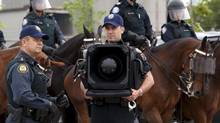 A police officer stands by with and LRAD-X 100 Acoustic Communication Device (sound cannon) during a demonstration of G20 security and crowd control measures in Toronto on Thursday June 3, 2010. (FRANK GUNN/THE CANADIAN PRESS)
