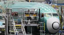 A technician works on the assembly of a Boeing 737 at the company's plant in Renton, Wash. (Ted S. Warren/AP)