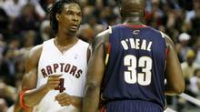Bosh and O'Neal rub up against one another during the first half. (Peter Power)