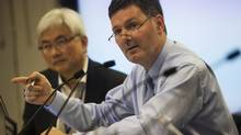 Councillor Glenn De Baeremaeker, right, pictured during a debate over whether to ban shark fin products on October, 13, 2011. (Michelle Siu For The Globe and Mail)