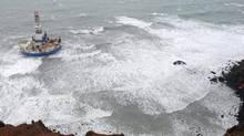 This aerial image provided by the U.S. Coast Guard shows the Royal Dutch Shell drilling rig Kulluk aground off a small island near Kodiak Island Tuesday Jan. 1, 2013. (Sara Francis/AP/U.S. Coast Guard)