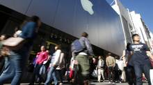 Holiday shoppers walk past an Apple Store in San Francisco, Calif., Nov. 23. News that personal income grew in all major American metropolitan areas in 2011 should bode well for the U.S. economy. (STEPHEN LAM/REUTERS)