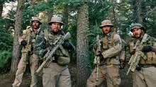 Taylor Kitsch, Mark Wahlberg, Ben Foster and Emile Hirsch in Lone Survivor. (AP)