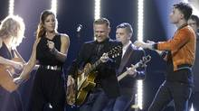 "Bryan Adams leads other performers, including Sarah McLachlan (2nd from L) in singing his ""Summer of '69"" at the 2017 Juno Awards in Ottawa. (Blair Gable/Reuters)"