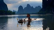 The Li River in Guilin, China, winds through an landscape of haunting peaks. (Alamy)