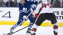 Toronto Maple Leafs forward David Clarkson, left, snaps the puck past Ottawa Senators defenceman Patrick Wiercioch, right, in Toronto on Tuesday, Sept. 24, 2013. (Nathan Denette/The Canadian Press)