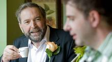 Deputy NDP leader Thomas Mulcair meets with supporters as voters cast their ballots in Montreal on May 2, 2011. (Graham Hughes/THE CANADIAN PRESS)